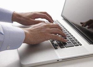 Business man using computer.